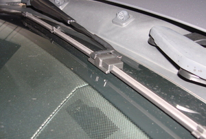 A car with windshield wiper blades.