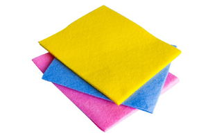 a stack of pink, blue, and yellow cloths