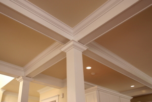 A warm, decorative ceiling in a home.