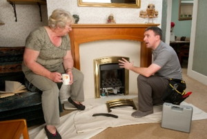 Man talking to a woman about fireplace