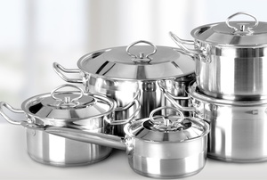 set of silver cooking pots in varying sizes