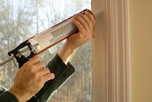 Caulking a window