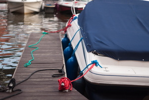 a covered boat tied to a dock