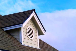 An attic vent with a louvered cover.