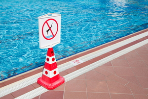 "a red cone with a ""do not dive"" sign on it"