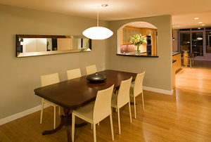 A luxury condo dining room with a bamboo wood floor.