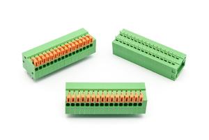 Three green terminal blocks against a white background.