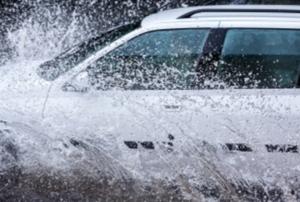 A car driving through water.