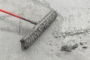 A broom resurfacing wet concrete.
