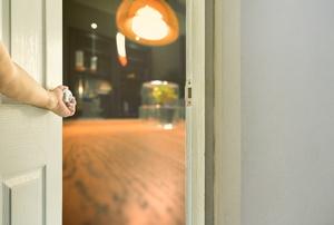 an arm opening a door