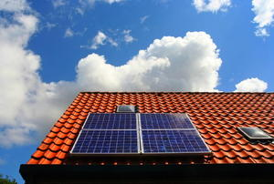 Solar panels on a terracotta roof.
