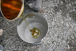 Mixing epoxy in a bucket