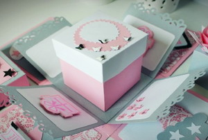 a layered birthday box in pink, white, and gray paper