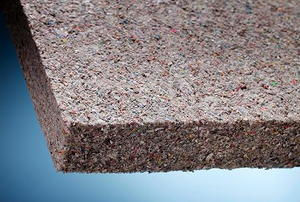 Extreme close-up of the corner of a piece of cellulose insulation.