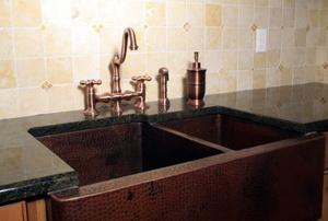 A copper kitchen sink.