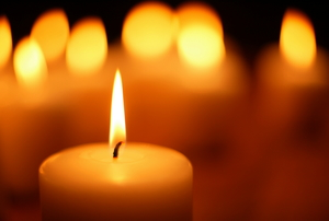Several lit candles give off a soft light.