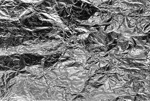 A background of wrinkled tin foil.
