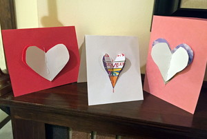 A trio of homemade Valentine's Day cards with 3-D hearts.