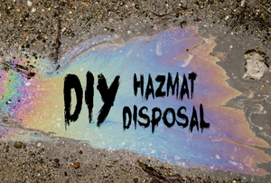 "A pool of oil in the street with the words ""DIY hazmat disposal."""