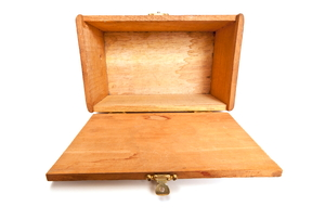 an open, empty wooden box from the top