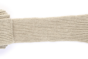 A rolled up, hand knit wool scarf on a white background.
