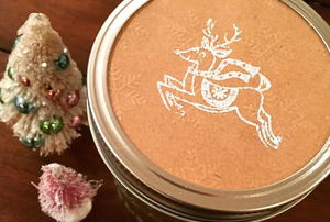 A mason jar lid embossed with a reindeer.