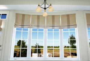 Roman shades on four tall windows