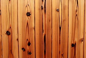 A row of knotty pine planks, nailed down.