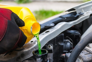 Radiator Fluid being poured into a car