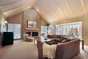A room with vaulted ceiling lighting.