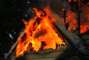 A house fire burning through an attic.