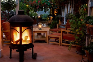 An outdoor patio area where people can grill, dine, and relax.