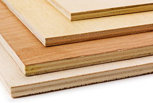 Several different types of plywood stacked on top of one another.
