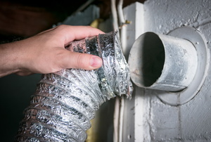 attaching a dryer hose to the vent