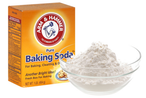 box of baking soda with a bowl next to it