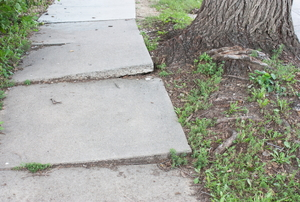 dangerous uneven concrete sidewalk
