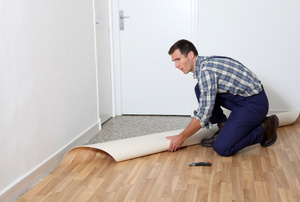 A man works with linoleum floors.