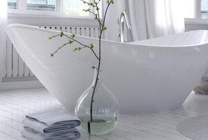 stylish bathroom with freestanding curved bathtub