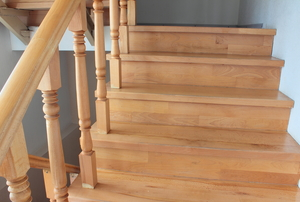 unpainted wooden stairs and railing