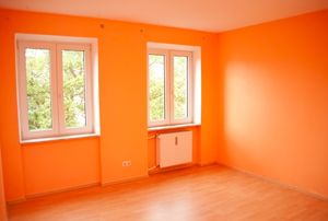 An orange room, charged with energy.