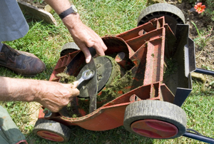 Cleaning the underside of a lawn mower