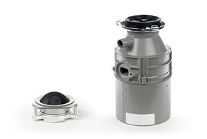 Two components to a garbage disposal sit against a white background.