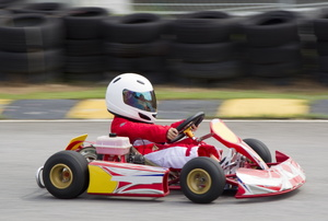 a person in a red go kart