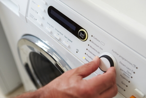 turning dial on washing machine