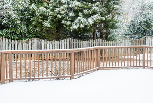 a snow covered fence