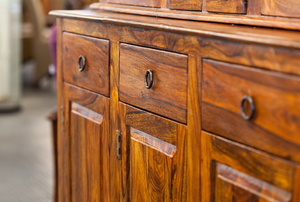 A close-up of a wood cabinet.