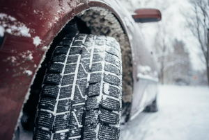 A car tire in snow.