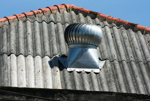 Galvanized roof with a fan and flashing.