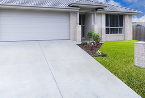 A driveway made of exposed aggregate concrete.