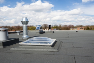 a rooftop with blue sky in the background